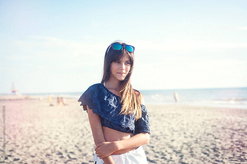 Portrait of young girl on a beach by Carlo Amoruso for Stocksy United