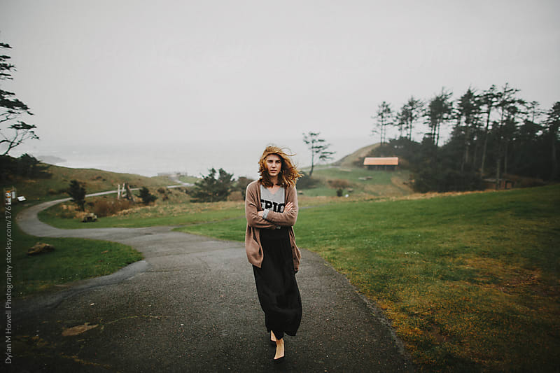 girl walking near oregon coast by Dylan M Howell Photography for Stocksy United