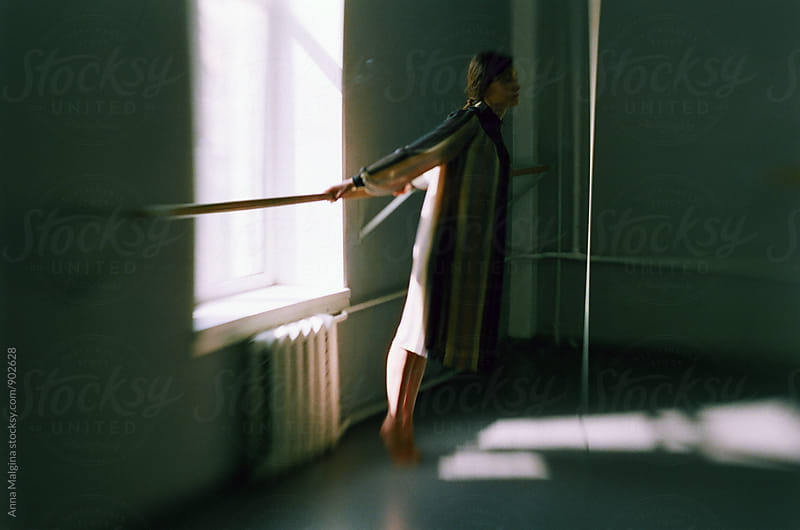A film portrait of a young beautiful woman  in dance class by Anna Malgina for Stocksy United