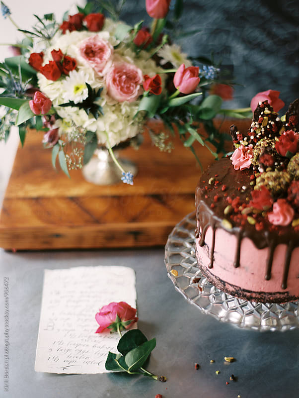 cake and flowers by Kirill Bordon photography for Stocksy United