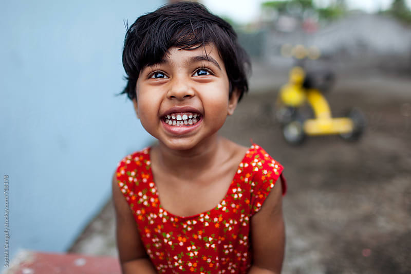 Cute little girl laughing by Saptak Ganguly for Stocksy United