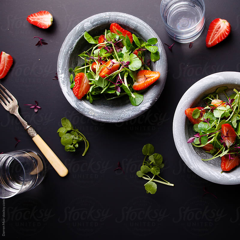 Strawberry salad. by Darren Muir for Stocksy United