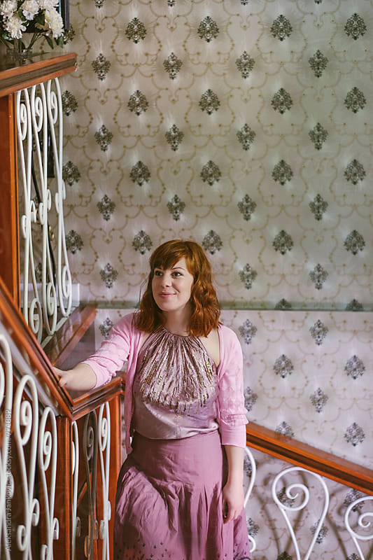 Pretty Ginger Woman on the Staircase by Aleksandra Jankovic for Stocksy United