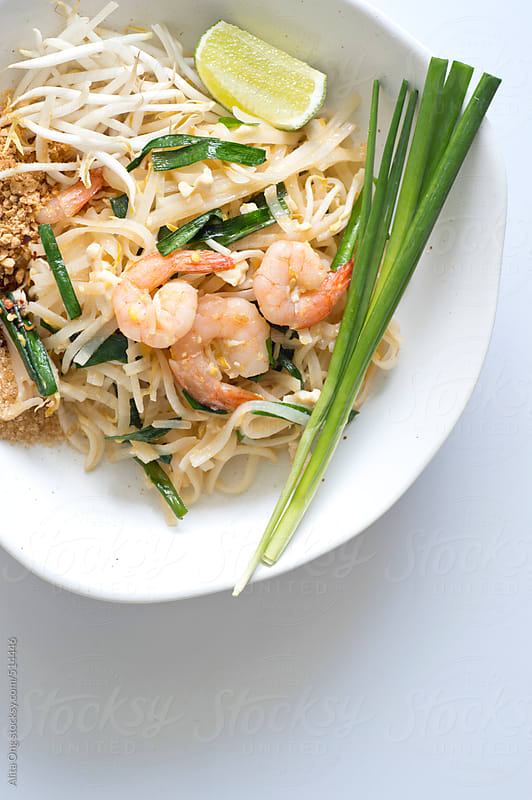 Phad thai on white background with copyspace by Alita Ong for Stocksy United