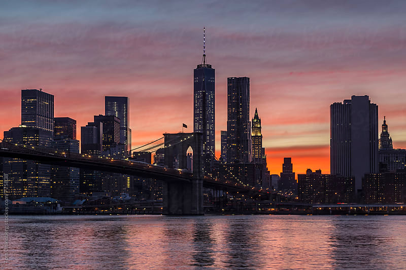 New York City - Lower Manhattan Skyline and Brooklyn Bridge at Sunset by Tom Uhlenberg for Stocksy United