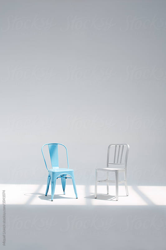 Couple of different chairs in the studio by Miquel Llonch for Stocksy United