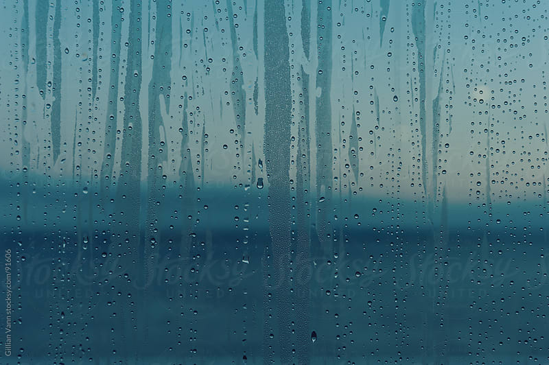 wet window pane by Gillian Vann for Stocksy United