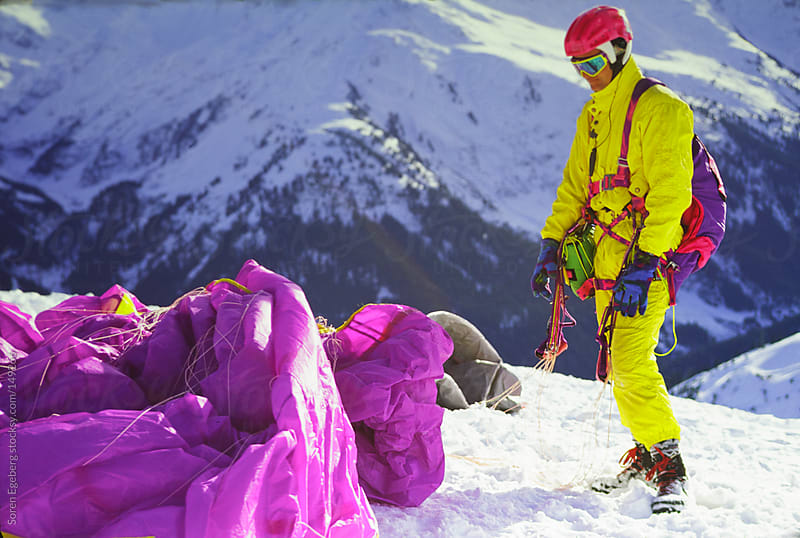 Man preparing for paragliding in winter mountains with snow by Soren Egeberg for Stocksy United