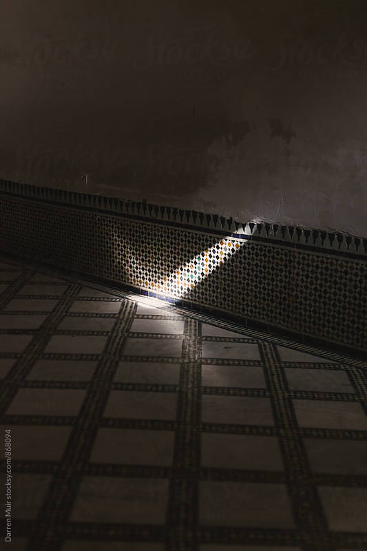 Patch of light on a tiled wall. by Darren Muir for Stocksy United