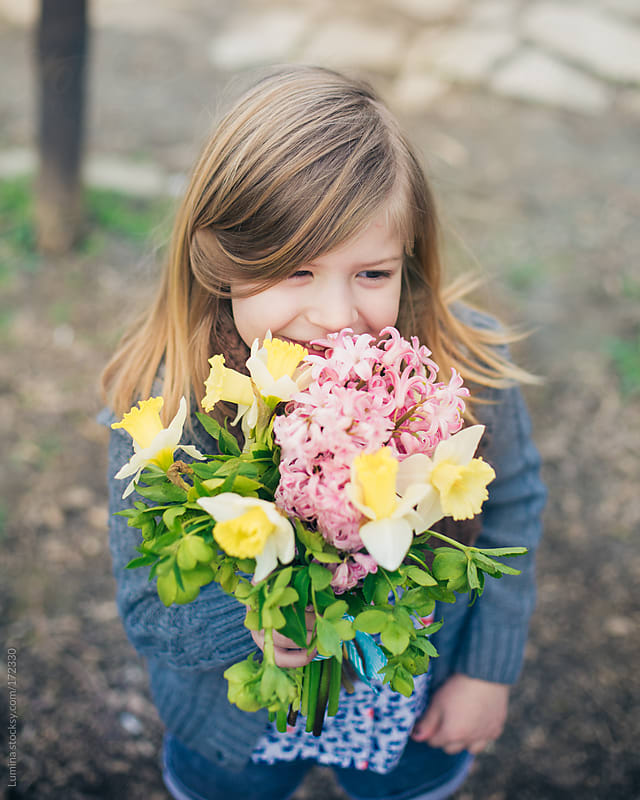 Portrait of a Girl Holding a Bouquet by Lumina for Stocksy United