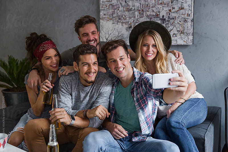 Group of friends taking a selfie  by Jovo Jovanovic for Stocksy United