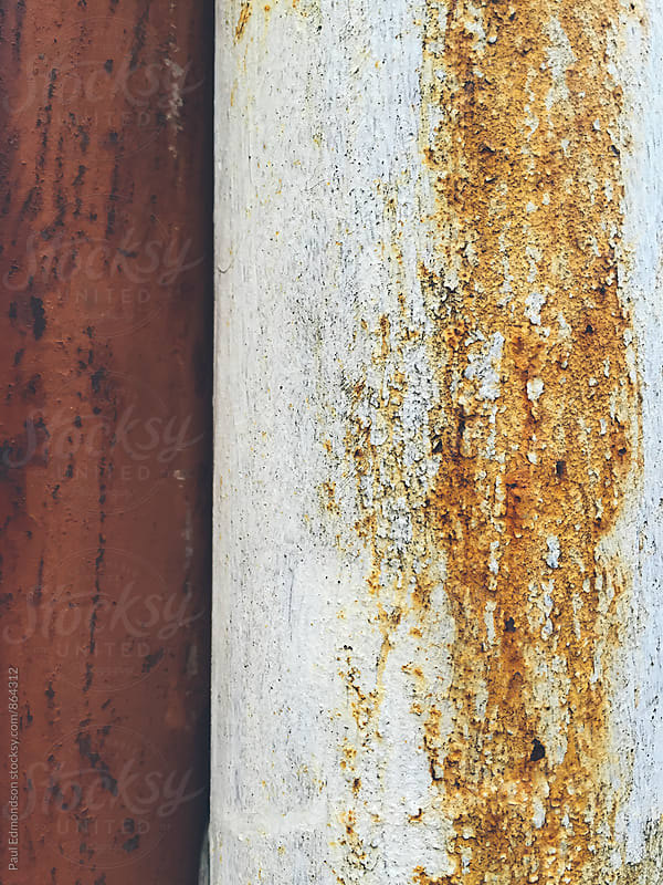 Close up of rusty, metal utility pipes by Paul Edmondson for Stocksy United