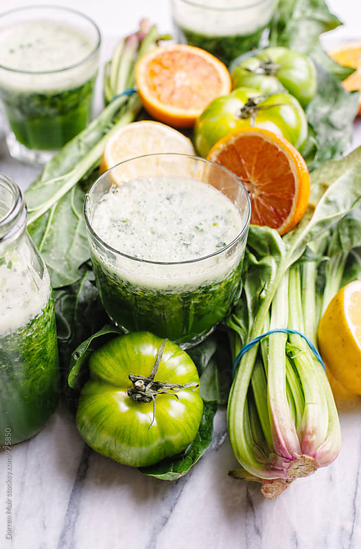 Making healthy detox drinks. by Darren Muir for Stocksy United