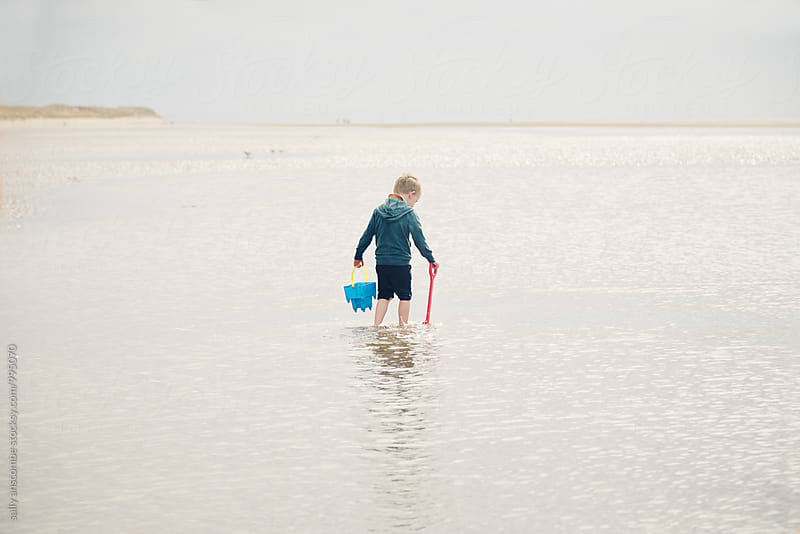 Little boy paddling in the sea by sally anscombe for Stocksy United