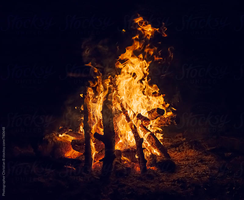 Campfire at night by Photographer Christian B for Stocksy United
