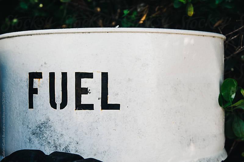 Metal barrel with Fuel label by Gabriel (Gabi) Bucataru for Stocksy United