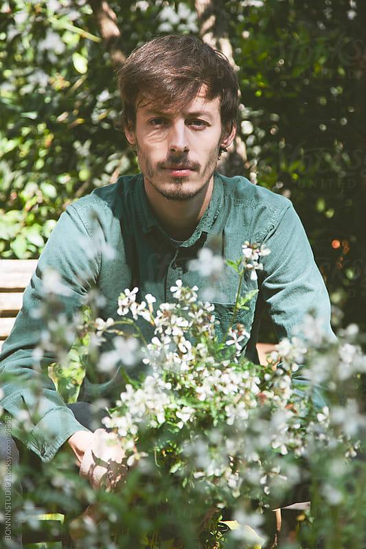 Young modern gardener man with fresh arugula on orchard. by BONNINSTUDIO for Stocksy United