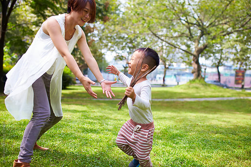 happy asian kid with his mother in the park by Bo Bo for Stocksy United