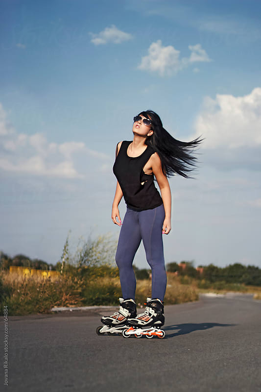 Beautiful girl in nature rollerblading by Jovana Rikalo for Stocksy United