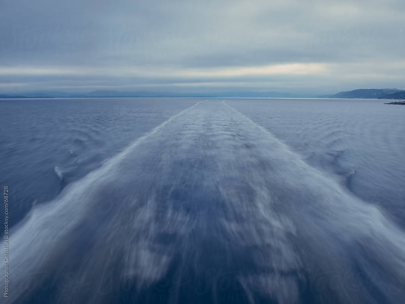 Wake behind a ferry by Photographer Christian B for Stocksy United