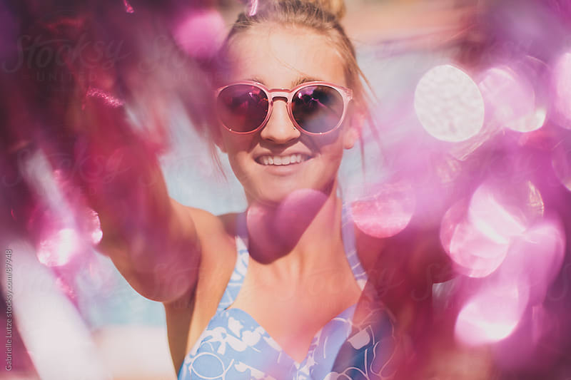 Pool Party Girl with Pom-Poms by Gabrielle Lutze for Stocksy United