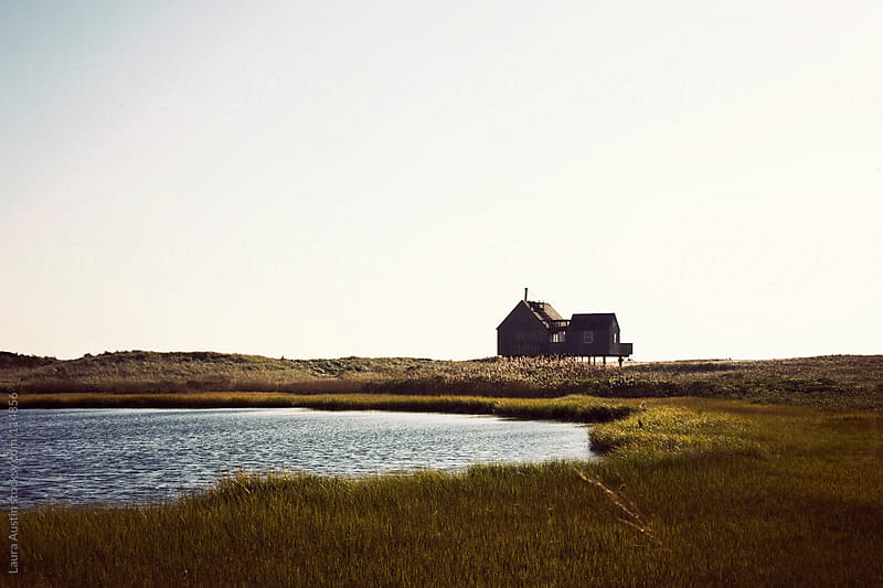 Old House On Stilts Near A Pond In Nantucket by Laura Austin for Stocksy United