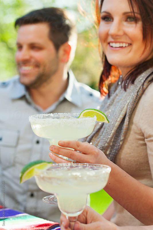 Cinco: Focus On Margarita While Woman Talks To Friends by Sean Locke for Stocksy United