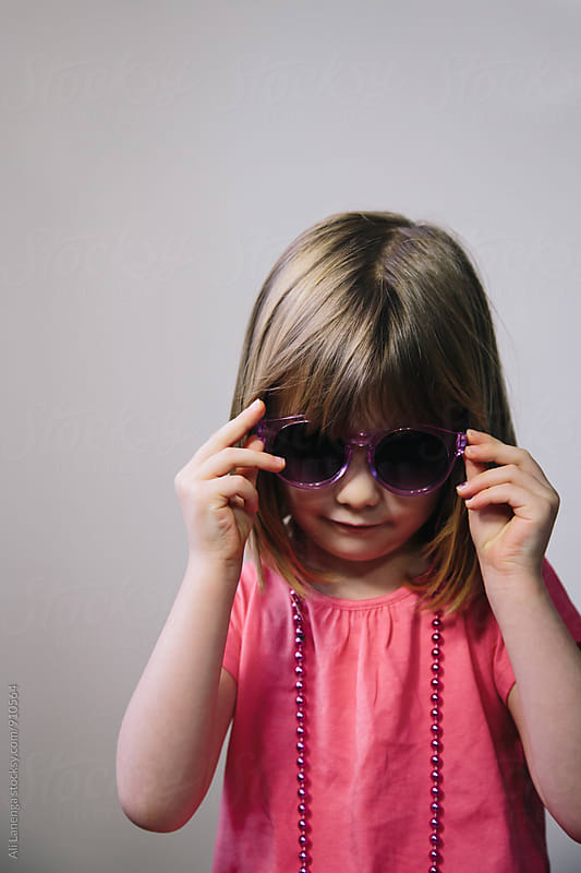 Girl in sunglasses by Ali Lanenga for Stocksy United