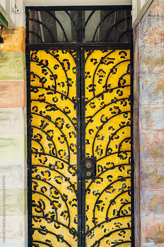 Ornated metal door by Gabriel (Gabi) Bucataru for Stocksy United