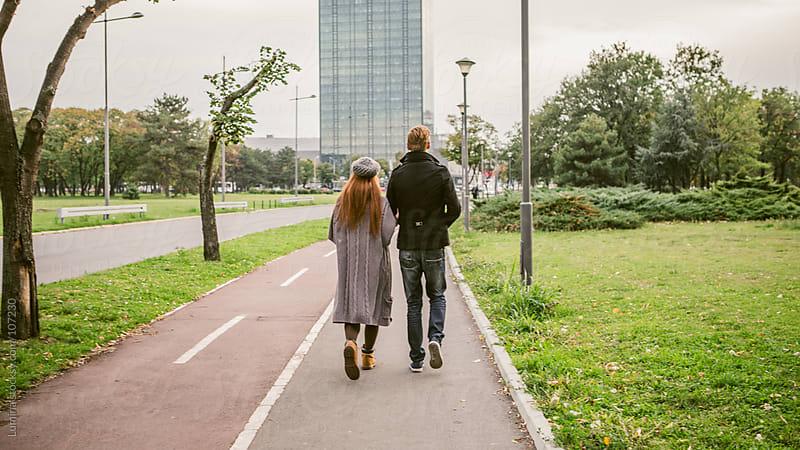 Ginger Couple Having a Walk by Lumina for Stocksy United