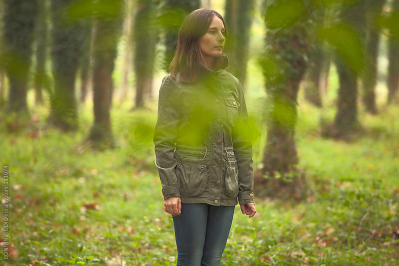 Woman standing on an autumnal forest. by BONNINSTUDIO for Stocksy United
