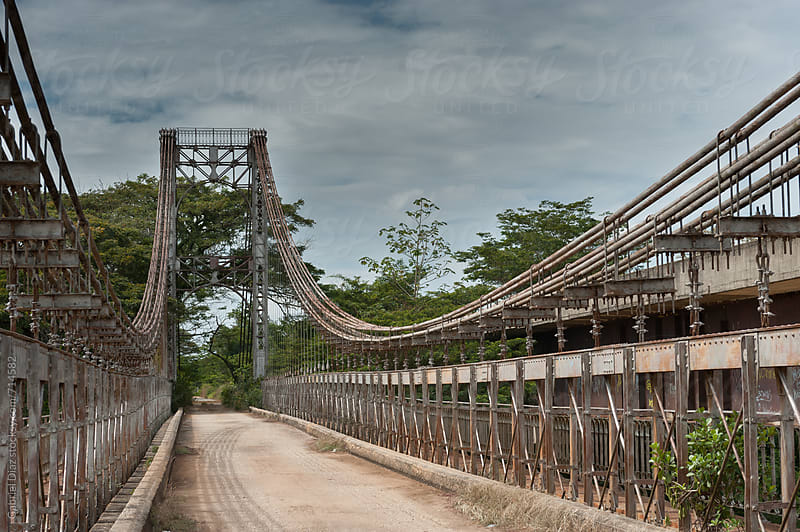 Old abandoned bridge over the river  by Gabriel Diaz for Stocksy United