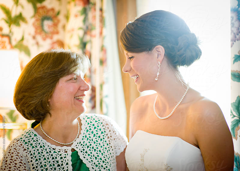 Wedding: Mother and Daughter Prepare in Hotel Room by Brian McEntire for Stocksy United