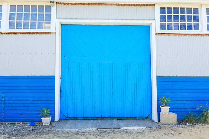 Large blue door. Western Australia. by John White for Stocksy United
