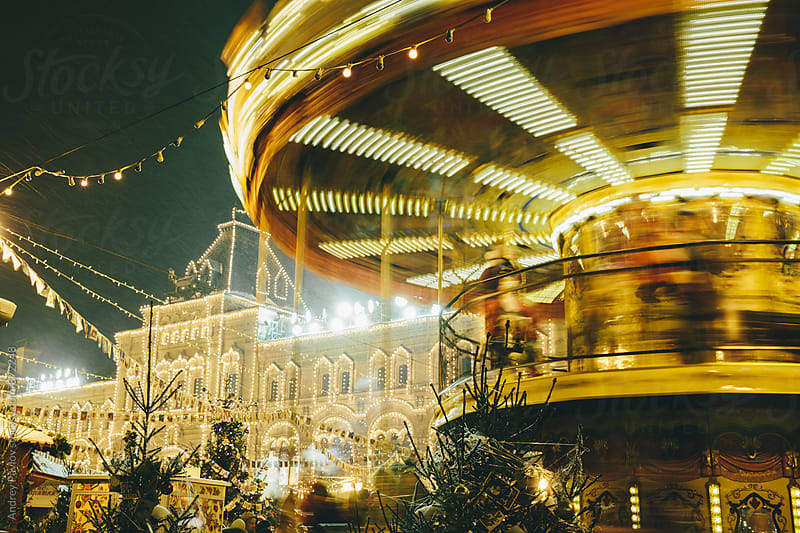 Illuminated carousel in motion by Andrey Pavlov for Stocksy United