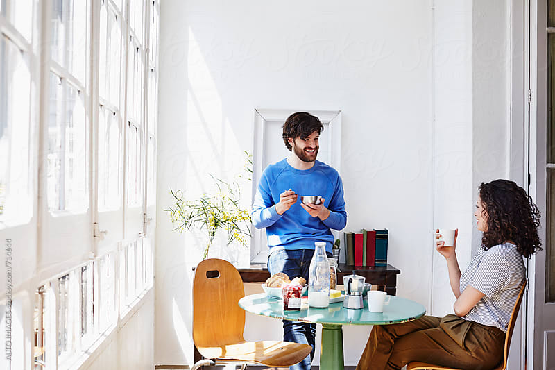 Smiling Couple Having Breakfast At Home by ALTO IMAGES for Stocksy United