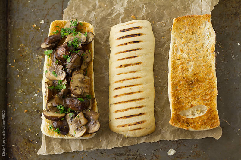 Garlic mushroom bruschetta trio by Kirsty Begg for Stocksy United