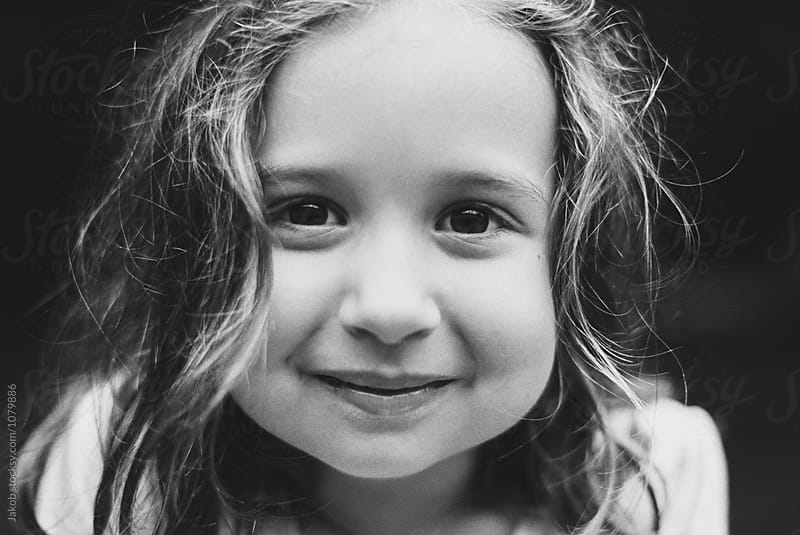 Close up portrait of a beautiful young girl in black and white by Jakob for Stocksy United