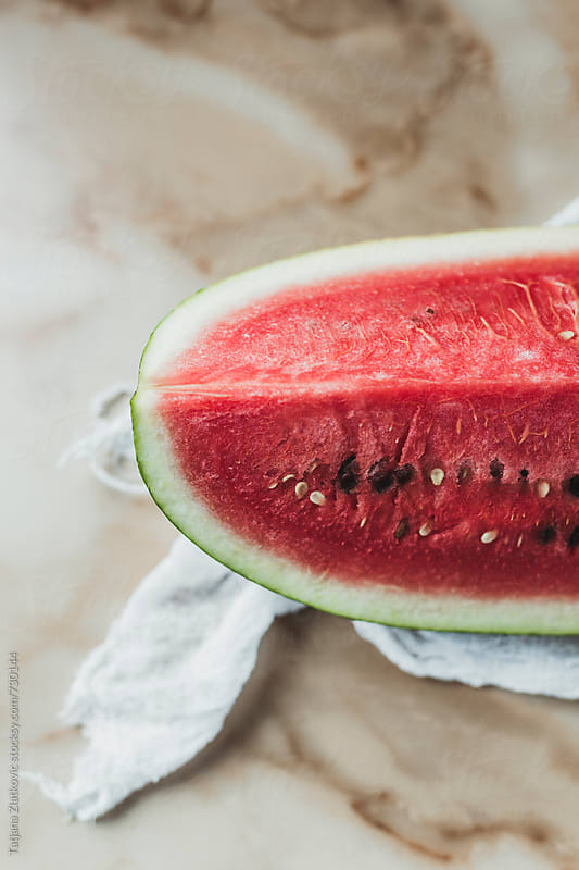 Watermelon on a marble background by Tatjana Ristanic for Stocksy United