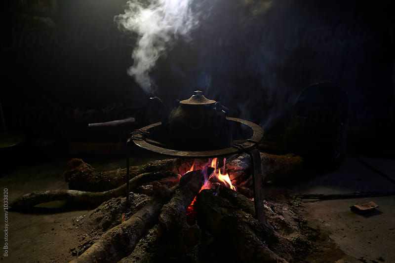 tea pot on campfire by Bo Bo for Stocksy United