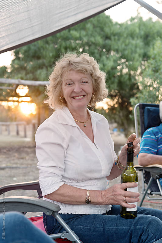 retiree on holiday by Gillian Vann for Stocksy United