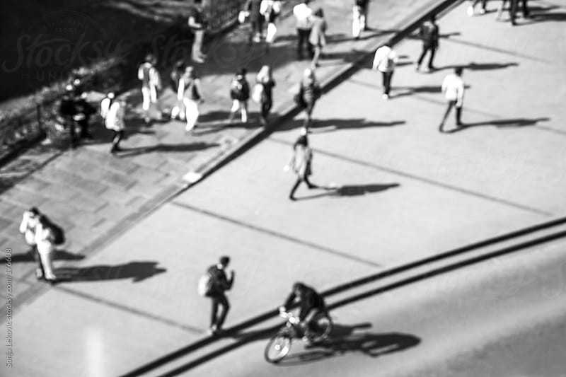 defocused people in the street from above in black and white by Sonja Lekovic for Stocksy United