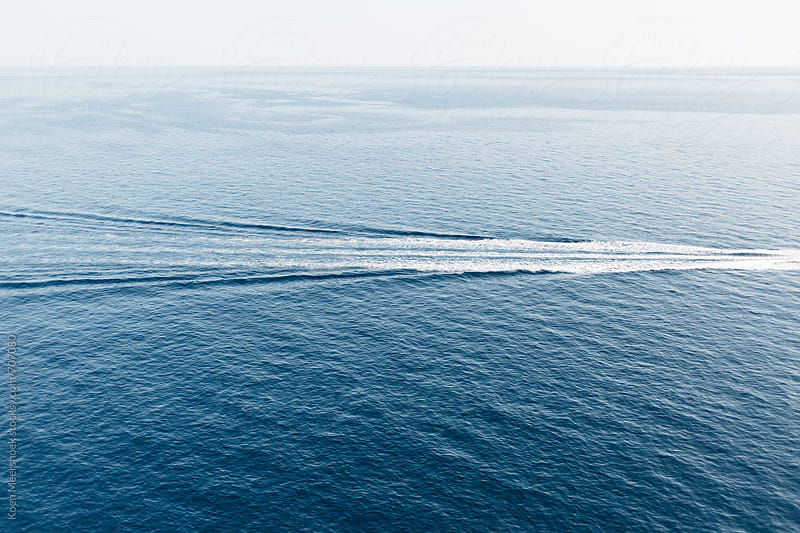 Waves from a boat in the middle of the sea by Koen Meershoek for Stocksy United
