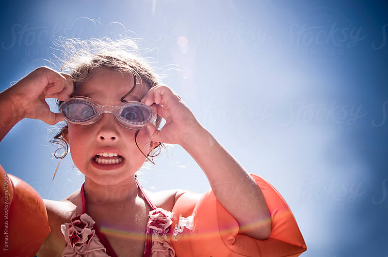 swimming goggles  by Tomas Kraus for Stocksy United