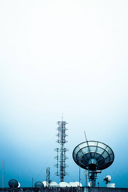 Rooftop satellite dishes and aerials for radio and television broadcast by Micky Wiswedel for Stocksy United