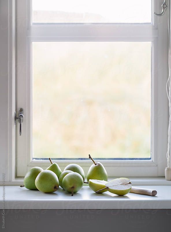 Wooden window with local pears by Elisabeth Coelfen for Stocksy United