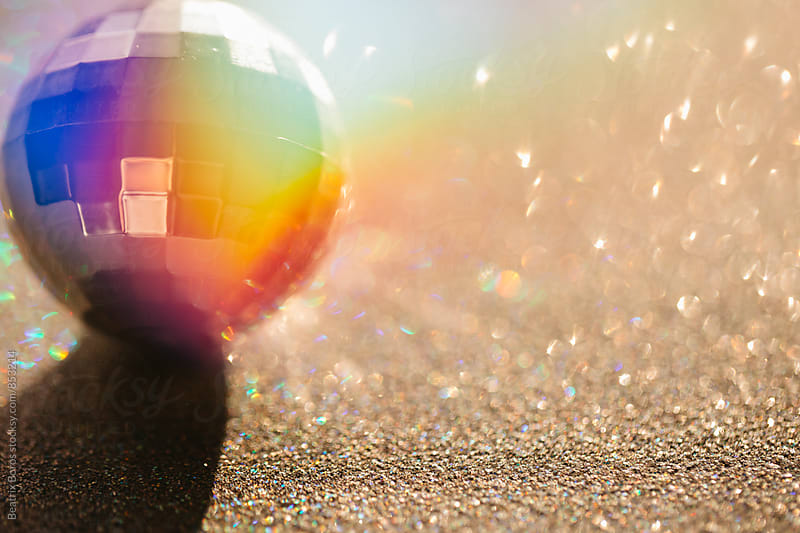 Double exposure disco ball with colorful light by Beatrix Boros for Stocksy United