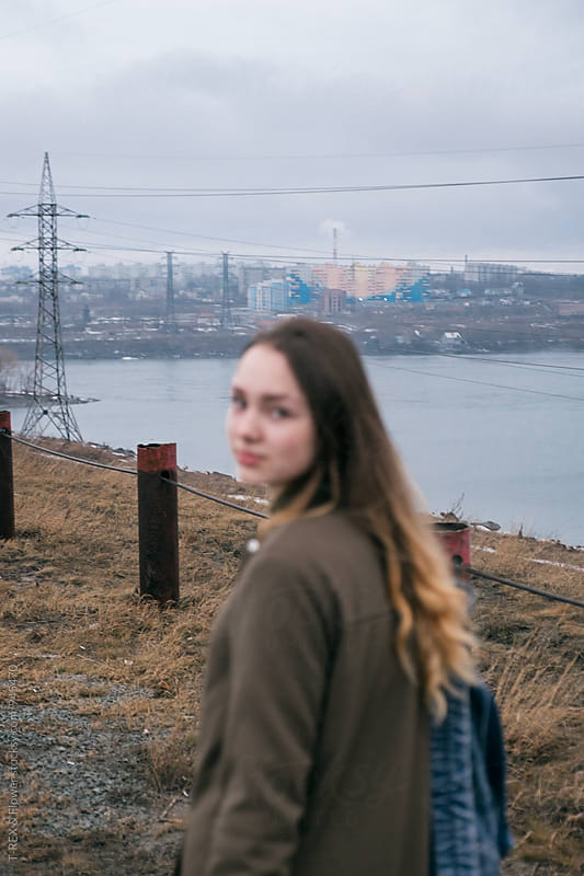 Unfocused foreground with young woman  by Danil Nevsky for Stocksy United