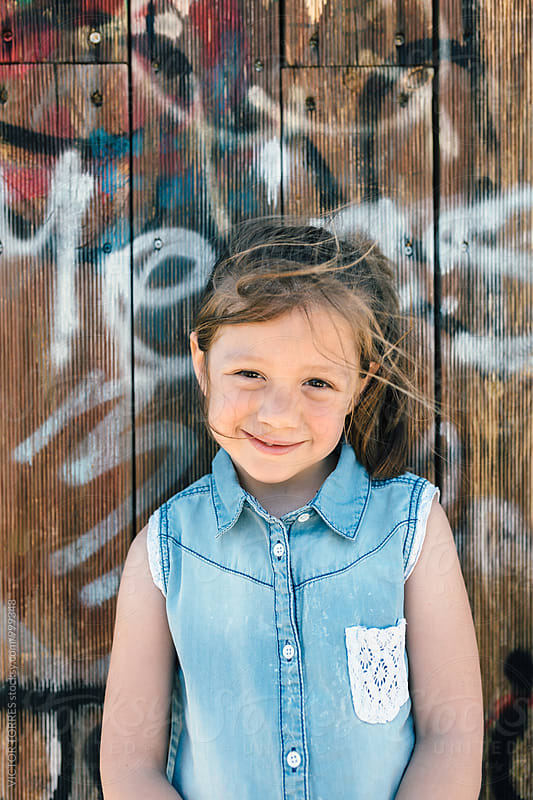 Portrait of Cute Little Girl Wearing a Denim Jacket by Victor Torres for Stocksy United