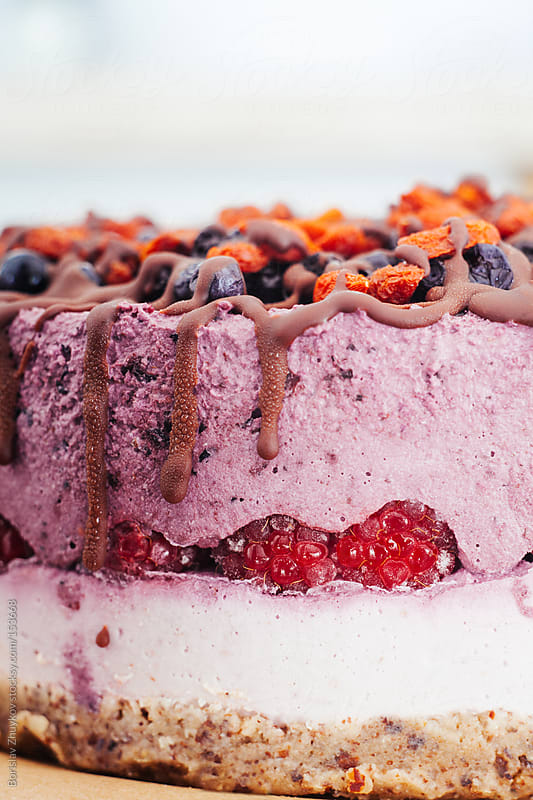 Close up of purple raw vegetarian cake  by Borislav Zhuykov for Stocksy United